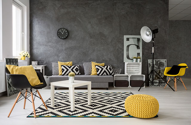 Grey walls in this modern living room with yellow accents