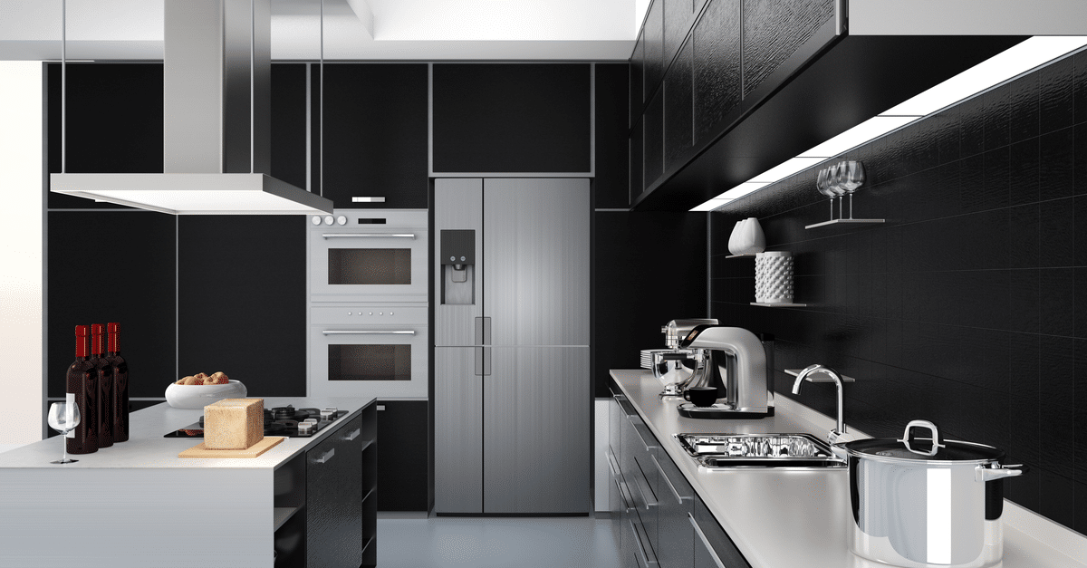 a black painted and black cabinets with aluminum accents and white counters