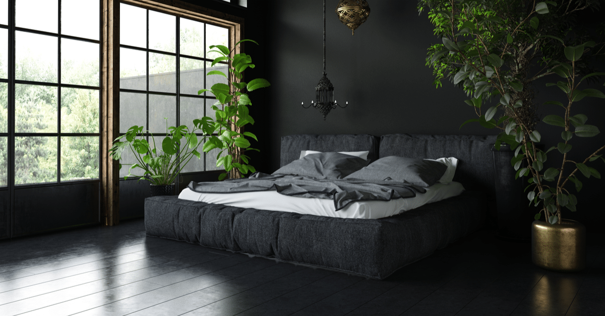 Black paint bedroom is stunning with matching black bedding and white sheets