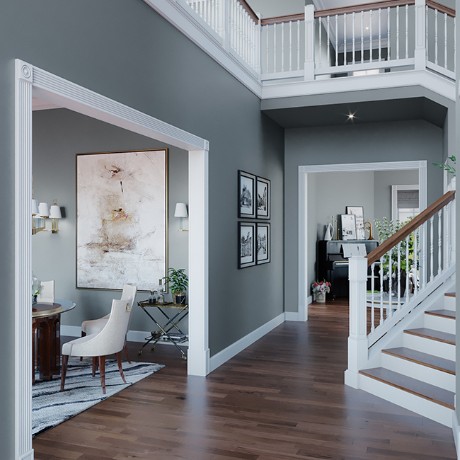 entry with grey paint and white trim molding, staircase and rail.