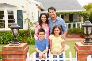 happy customers that stand in front of freshly painted home