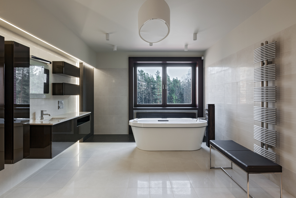 black window sills and black cabinets in a white bathroom