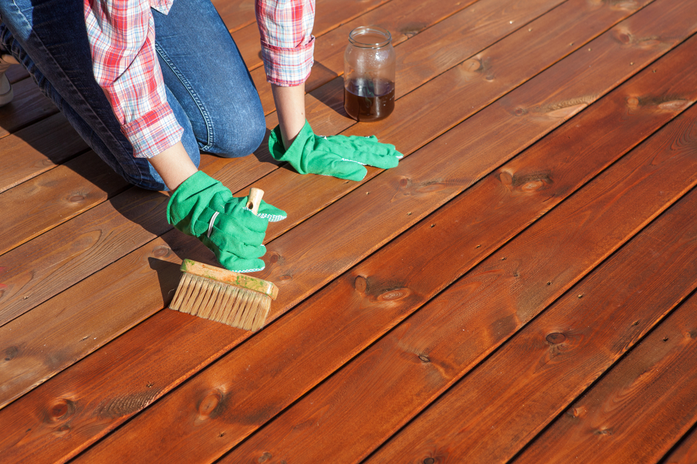 staining a deck after sanding and power washing it