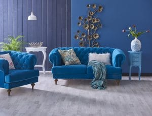 This living room spilts the wall down the center creating a textured statement wall in blue tones