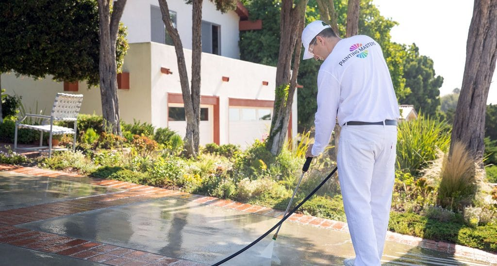 power washing driveway of luxury home